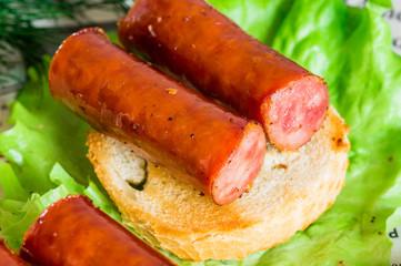 Tapas appetizer with smoked sausage