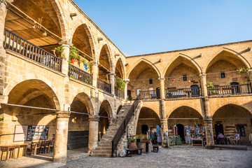 NICOSIA, CYPRUS - AUGUST 10, 2015: Buyuk Han (The Great Inn) a touristic center with an antique souvenir shops, craft workshops and cafes in Nicosia, Cyprus on August 10,2015