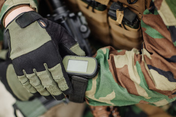 ranger holding gps in hand and determines the location of coordi