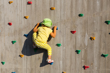 Child on wall
