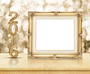 Golden Vintage frame with 2016 year wood texture with sparkling