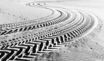 tire tracks prints in beach sand