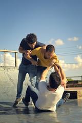 Three men fighting