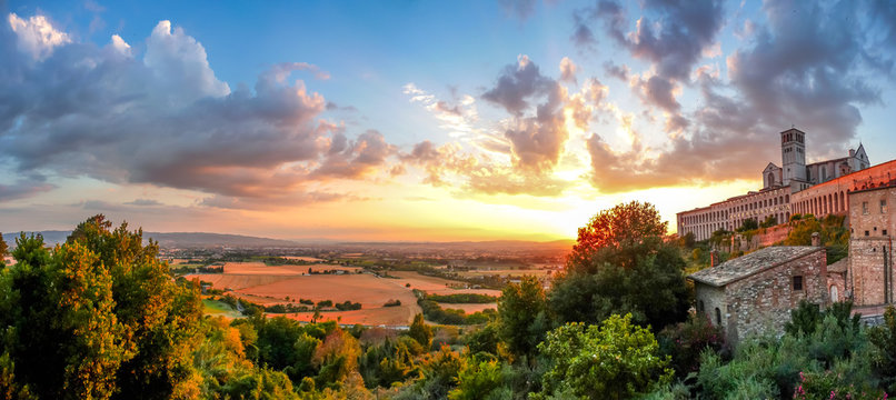 Amazing view of Basilica of St. Francis of Assisi at sunset, Umbria, Italy