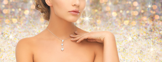 woman wearing shiny diamond pendant