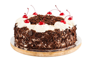 Black forest cake decorated with whipped cream and cherries