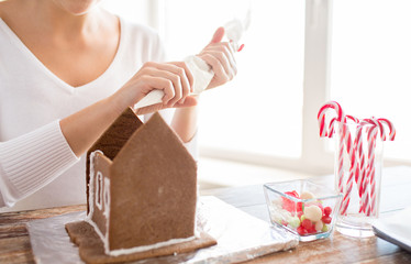close up of woman making gingerbread houses