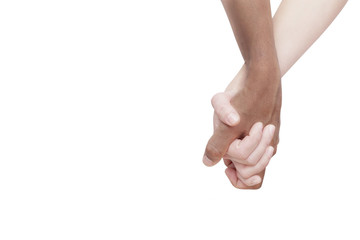 Interracial couple holding hands on white background