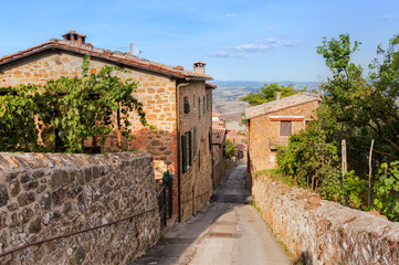 Fototapete - Street and houses in Montepulciano, Tuscany, Italy,