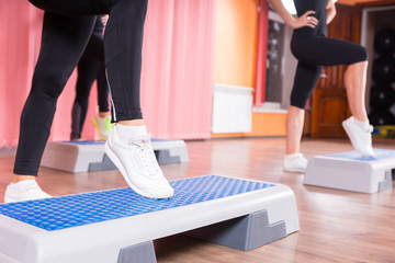 Close Up of Woman Wearing Sneakers in Step Class