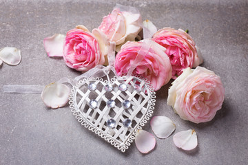 Decorative white heart  and  pink roses