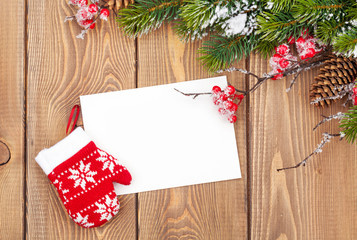 Christmas tree branch and blank greeting card