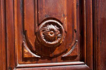 Old wooden flower detail on a door