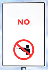 A sign showing no shooting allowed, with white background