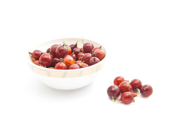red gooseberries on a glass dish