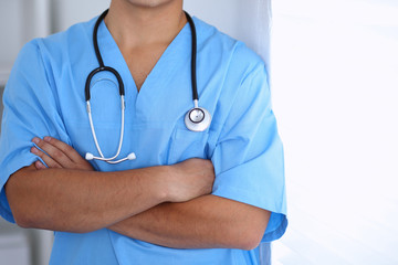 Portrait of unknown male surgeon doctor standing near the wall  in hospital office, stethoscope