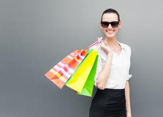 Happy shopping! Beautiful woman holding shopping bag.