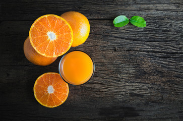 orange juice from above on wood table