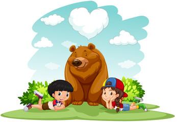 Children sitting with bear