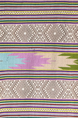 Colorful Thailand style rug surface close up vintage fabric is made of hand-woven cotton fabric