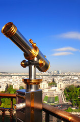 Telescope overlooking Paris up on Eiffel tower, France