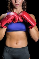 Midsection of female boxer with fighting stance