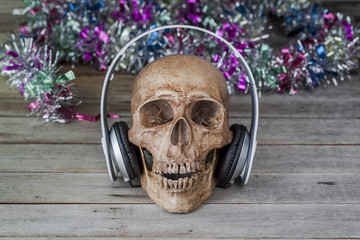 still life.Human skulls are listening with headphones
