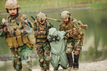 Army rangers captured a scientist with protective mask and prote