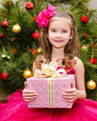 Adorable little girl with gift box