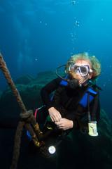 Woman scuba diver . Mediterranean sea.