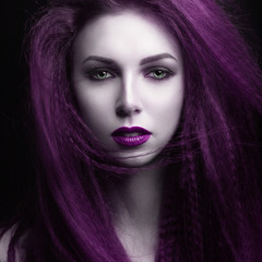 The girl with pale skin and purple hair in the form of a vampire