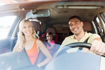 happy family with little child driving in car Wall mural