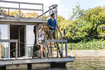 Couple having a trip on a house boat