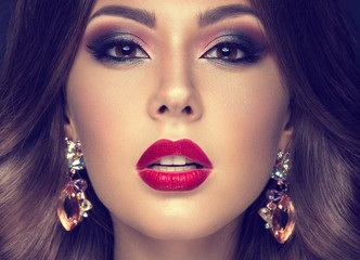 Beautiful woman with arabic make-up, red lips and curls. Beauty
