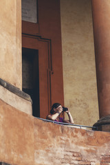 Female tourist taking pictures of architecture at San Luca in Bo
