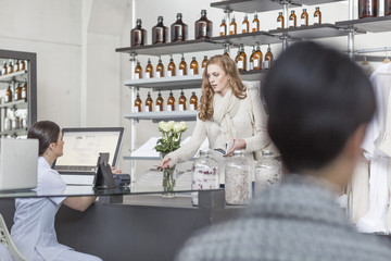 Client paying in wellness shop