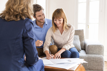 Young couple owners meeting real estate agent for investment