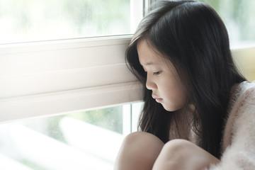 Portrait of asian beautiful sad girl