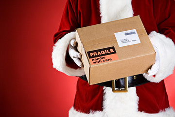 Santa: Holding A Package Ready For Shipping