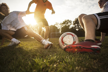 Sliding tackle on soccer pitch