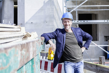Smiling architect on construction site