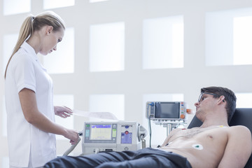 Young man in hospital getting heart rate monitored