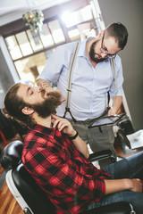 Barber with customer using digital tablet