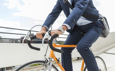 Businessman riding bicycle
