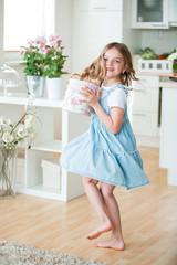 Little girl carrying gift box