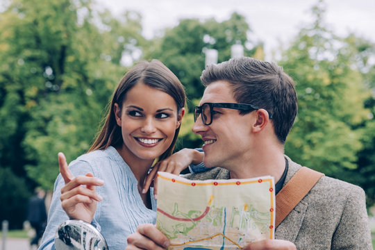 Young couple holding map looking for right direction