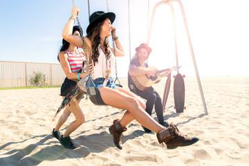 Hipster bohemian free spirits playing summer day sunny laughing enjoying life leisure