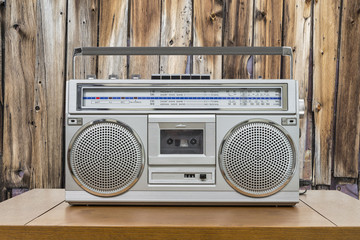 Vintage Boombox on Table with Rustic Cabin Wall