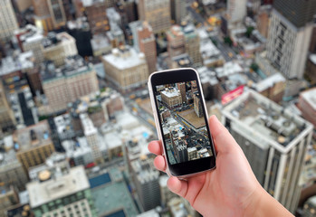 NYC aerial view through smartphone screen