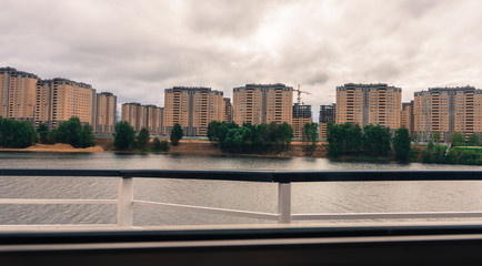new construction of  high rise buildings along the Volga River outside of Moscow, Russia seen from shiip
